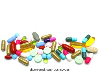 Assorted colorful pharmaceutical tablets capsules pills and herbal vitamins supplement isolated on white background wallpaper with copy space for text. Closed up Selective focus.