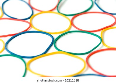 assorted of colorful rubber bands over white