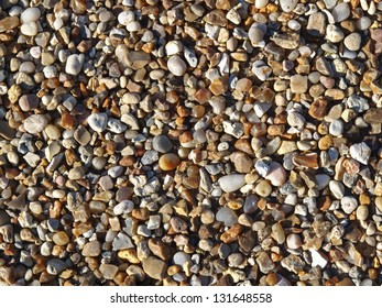assorted colorful and smooth pebbles from the beach