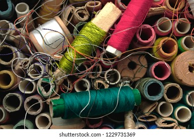 Assorted, colorful thread spools close up, full frame, top view