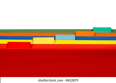 Assorted colors file folders with red in front of yellow and blue with orange and green featuring blank plastic tabs for copy space text over white