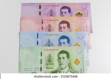 Assorted currency notes of Thailand Baht on white background.