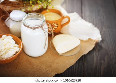 Assorted dairy products milk, yogurt, cottage cheese, sour cream. Rustic still life. Farmer's cow dairy products.