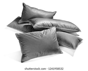 assorted dark gray feather pillows isolated