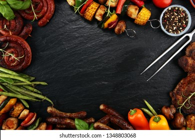Assorted delicious grilled meat and skewer with vegetable and herbs on rustic table