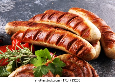 Assorted delicious grilled meat with vegetable on a barbecue with grilled sausages and vegetables. Food background and sausages