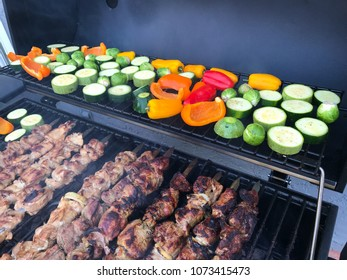 Assorted delicious grilled meat with vegetables on a barbecue, closeup