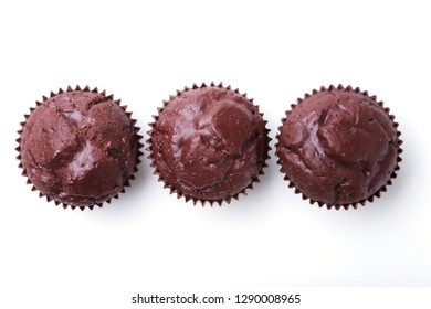 Assorted with Delicious homemade cupcakes with raisins and chocolate isolated on white background. Muffins. Top view. Copy space.