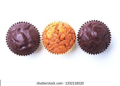 Assorted with Delicious homemade cupcakes with raisins and chocolate isolated on white background. Muffins. Top view.
