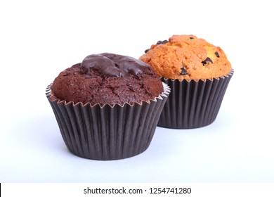 Assorted with Delicious homemade muffin, cupcake with raisins, nuts and chocolate isolated on white background.