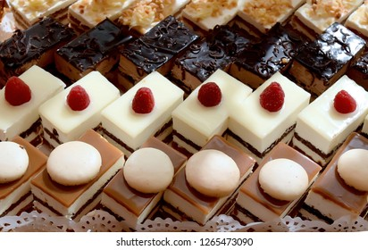 Assorted different mini cakes with cream, chocolate and berries-Sweets offered at the Moroccan wedding
