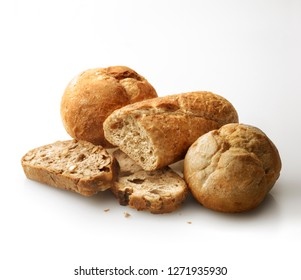 Assorted of different types of fresh bread against white background. Texture light effect.