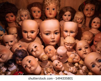 assorted doll collection scary faces