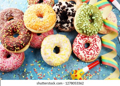 assorted donuts with chocolate frosted, pink glazed and sprinkles donuts. carnival concept.