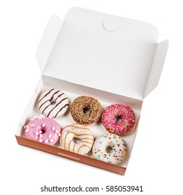 assorted donuts with different fillings in the box isolated on white background