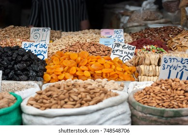Assorted dried fruits and nuts for sale at Mahane Yehuda Market, popular marketplace in Jerusalem, Israel