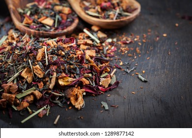 Assorted dry tea leaves on wooden background