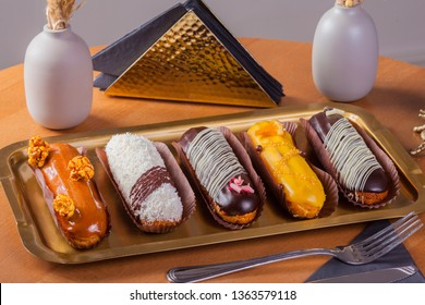 assorted eclairs different colors and tastes
