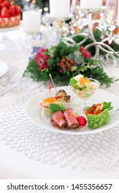 Assorted festive appetizers with avocade mousse,roast beef,marinated salmon,oil pickled oysters and aspic jelly