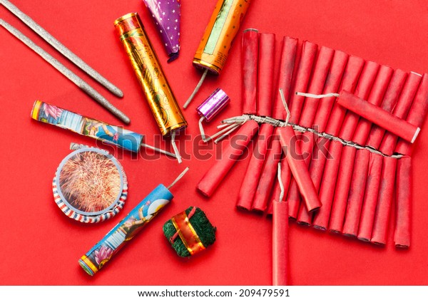 Assorted firecrackers for Diwali festival on red background