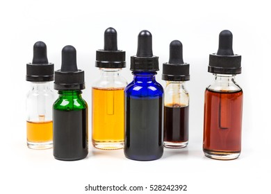 Assorted flavors of vape juice isolated on white background