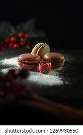 Assorted fondant Parisian recipe frozen macaroons shot against a dark, festive background with accommodation for copy space. The perfect image for your dessert menu cover art.