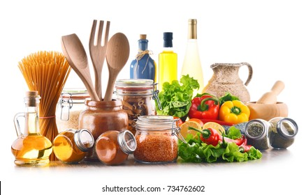 Assorted food products and kitchen utensils isolated on white background
