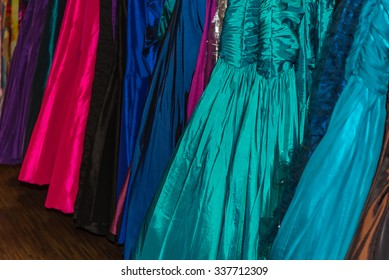 Assorted formal dresses in different colors for sale in retail store.  Prom gown and wedding dress detail, perfect for fashion trends and business blog and website