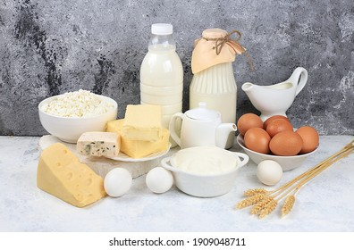 Assorted fresh dairy products, healthy breakfast with ingredients, natural nutrition concept, maintaining healthy intestinal microflora, diet nutrition, rustic table, selective approach