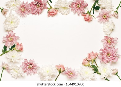 Assorted fresh flowers composition as frame on white background. Top view point, flat lay.