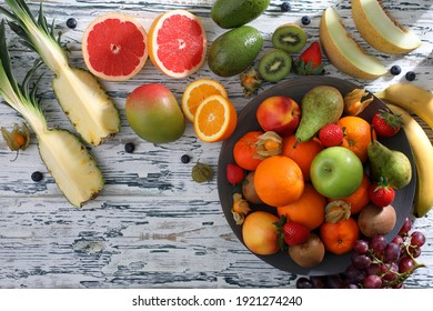 assorted fresh fruit on rustic table background