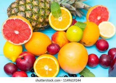 Assorted fresh healthy summer fruit in a full frame background on blue wood in a healthy diet and nutrition concept