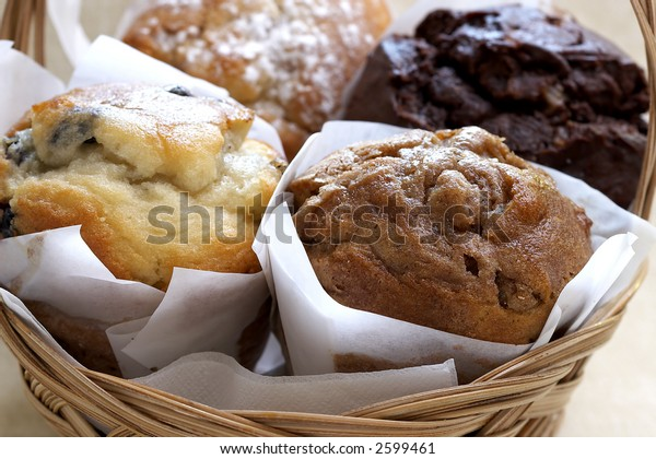 Assorted freshly baked muffins: Blueberry, Apple Cinnamon, Chocolate, and Raspberry
