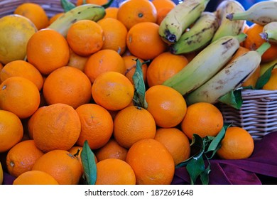 Assorted fruit: oranges and bananas