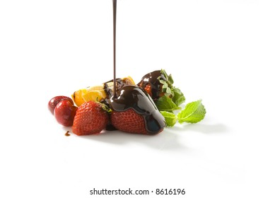 assorted fruits and chocolate sauce pouring still life isolated over white background