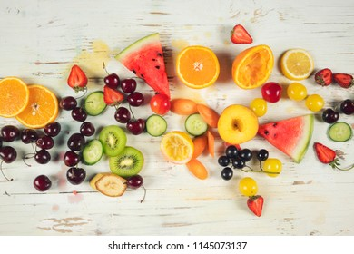 Assorted fruits on wooden background