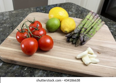 Assorted fruits and vegetables prepared on a cutting board