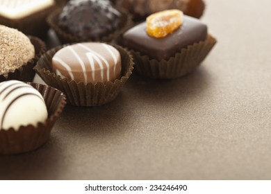 Assorted gourmet chocolate bonbons in paper cups