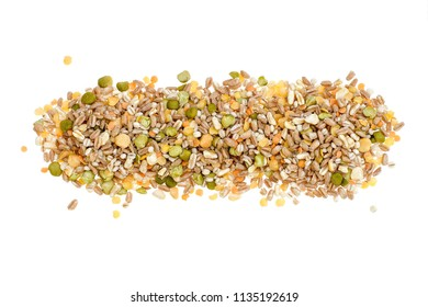 Assorted grains and pulses heap on white, top view. Winter food includes split peas, red and yellow lentils, pearl barley, kamut, spelt.