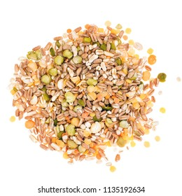 Assorted grains and pulses mix on white background, heap, top view. Winter food includes split peas, red and yellow lentils, pearl barley, kamut, spelt.