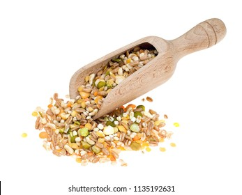 Assorted grains and pulses mix with wooden scoop, isolated on white. Winter food includes split peas, red and yellow lentils, pearl barley, kamut, spelt.