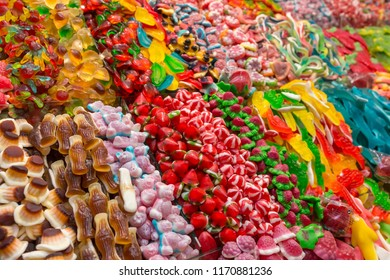 Assorted gummy candies in the shop. Jelly sweets in different shapes and colors