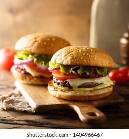 Assorted homemade burgers on wooden desk
