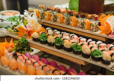 Assorted homemade fresh maki sushi served at seafood market buffet.