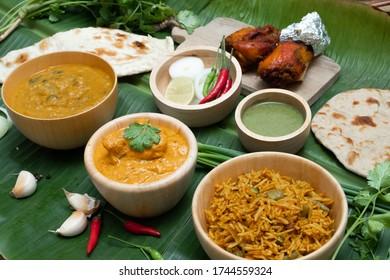 Assorted Indian cuisine Tandoori chicken with Biryani rice and Butter chicken.