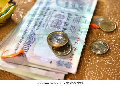 Assorted indian currency and coins. It is considered as a Goddess Laxmi in india.