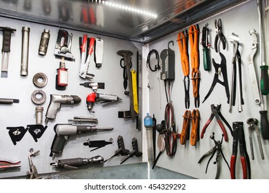 Assorted instruments for car maintenance on wall at service. Special tools for professional vehicle repairing