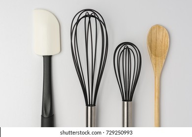 Assorted Kitchen Utensils on White Background Cropped Close Top View