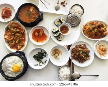 Assorted Korean food ,Kimchi stew(Jjigae) served with Kimbap(Sushi rolls) and Dak Galbi(Stir fry spicy pork)
