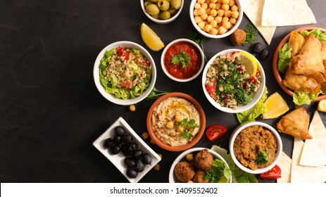 assorted of lebanese food with falafel, hummus,tabouleh,samosa and aubergine caviar